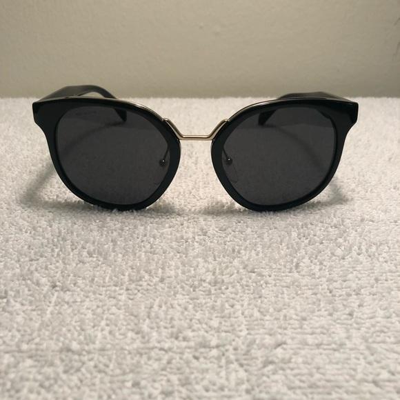 afe70e6ea34 PRADA SPR 17TS 1AB5S0 Black and Gray Sunglasses. M 5b831dc981bbc833b6e76e41